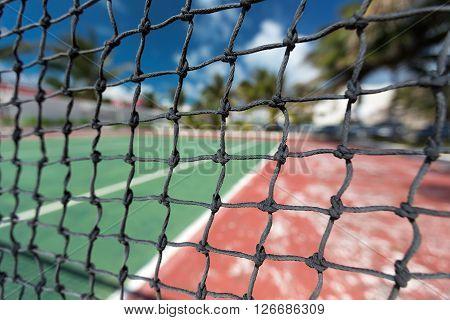 Tennis net outdoor at empty court. Macro shot. Background