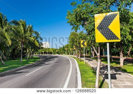 Road Signs Warning Drivers For Ahead Dangerous Curve