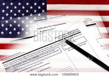 Immigration naturalization application and USA flag concept of citizenship and American patriotism.