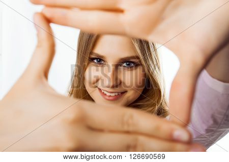 woman showing framing hand gesture on white background