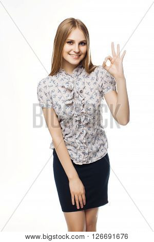 happy business woman showing ok gesture on white background