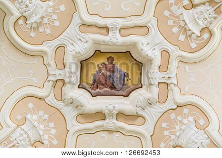 Marostica Italy - April 12 2016: Madonna and Jesus child painted on the ornate ceiling of a church.