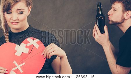 Sad Woman And Man Addicted To Alcohol. Broken Heart.