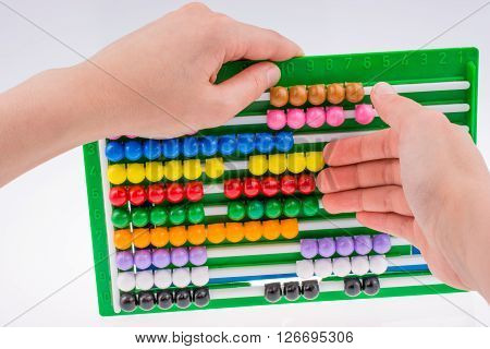 Hand Using An Abacus