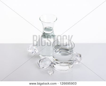 carafe and glass of fresh water with ice