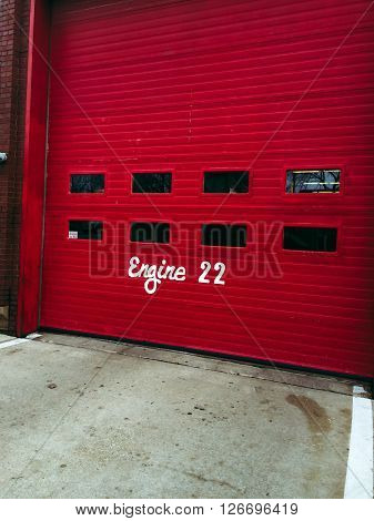 Front of Chicago fire station garage with words Engine 22 on front