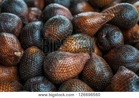 A shot of snake fruits taken at a local market in Bintulu Sarawak Malaysia. ** Note: Shallow depth of field