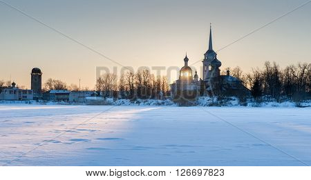 Nikolo Medvedsky Monastery in New Ladoga in sunset light. Novaya Ladoga Volkhov district Leningrad region Russia. Winter