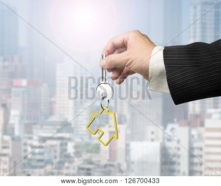 Man Hand Holding Key With House Shape Keyring