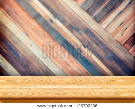Wood Table At Blurred Colorful Plank Wooden Wall In Background