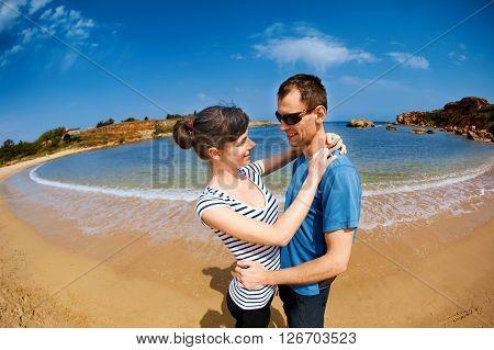 family walking on the sunny beach at the sunrise.  Area Chania city, Crete, Greece.