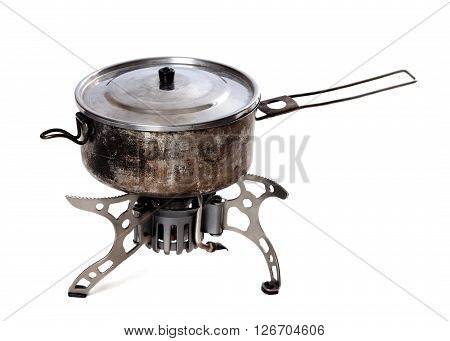 Camping gas stove and old sooty hiking pan. Isolated on white background
