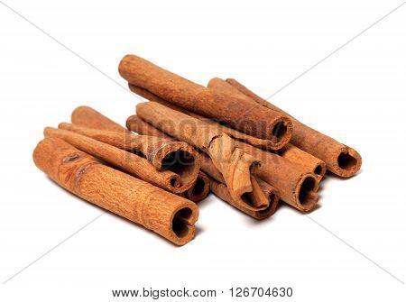 Cinnamon sticks isolated on white background .