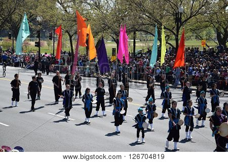 WASHINGTON, DC - APR 16: Flag-bearers at the 2016 National Cherry Blossom Parade in Washington DC, as seen on April 16, 2016. Thousands of visitors gathered to attend this annual event.