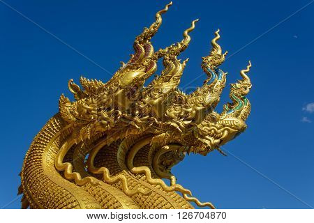 Naga four heads with blue sky background.