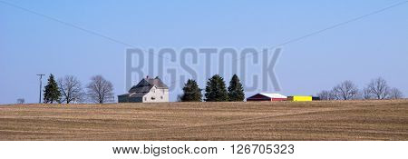 The fields around this farm house soon will be green as it is spring in Michigan.