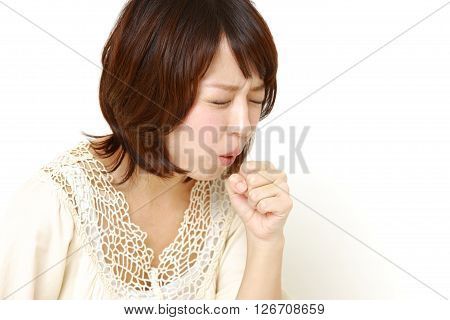 studio shot of young Japanese woman coughing?