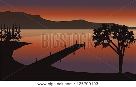 Pier at sunrise scenery with mountain backgrounds