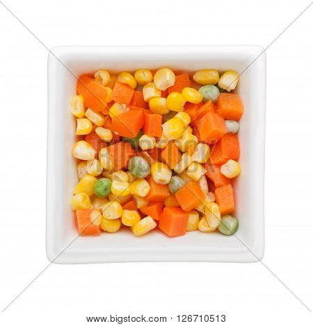 Mixed vegetables in a square bowl isolated on white background