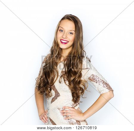 people, style, holidays, hairstyle and fashion concept - happy young woman or teen girl in fancy dress with sequins and long wavy hair
