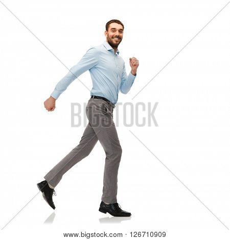 happiness, freedom, movement and people concept - smiling young man running away