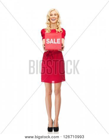 people, shopping, discount and holidays concept - smiling woman in red dress holding cardboard box with sale and percentage sign
