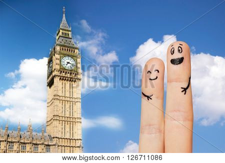 family, couple, travel, tourism and body parts concept - close up of two fingers with smiley faces over big ben clock tower and blue london sky background