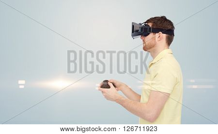 3d technology, virtual reality, entertainment and people concept - happy young man with virtual reality headset or 3d glasses playing with game controller gamepad over gray background