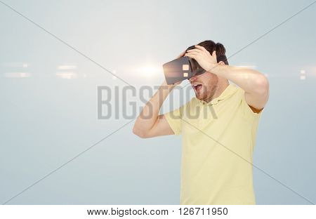 3d technology, virtual reality, entertainment and people concept - happy young man with virtual reality headset or 3d glasses playing game over gray background