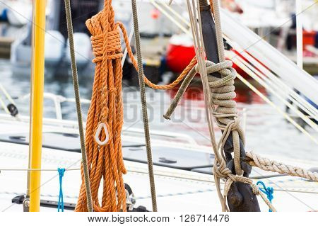 Yachting coiled rope on deck of sailboat details and part of yacht