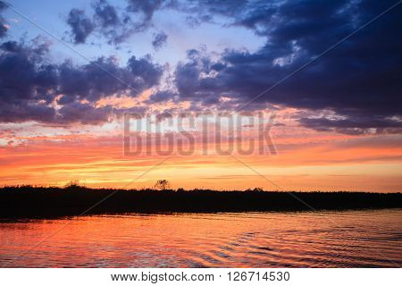 Sunset over water from