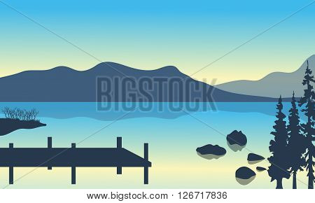 Lake and pier scenery with mountain of silhouette