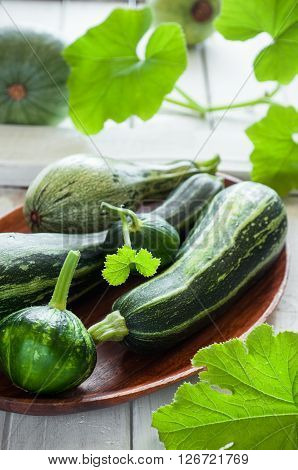 Close up of fresh organic zucchini on the wooden table vertical