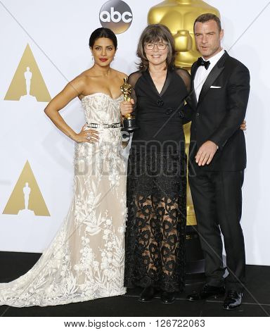 Liev Schreiber, Margaret Sixel and Priyanka Chopra at the 88th Annual Academy Awards - Press Room held at the Loews Hotel in Hollywood, USA on February 28, 2016.