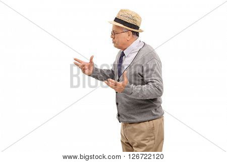 Studio shot of a annoyed senior man arguing with someone isolated on white background
