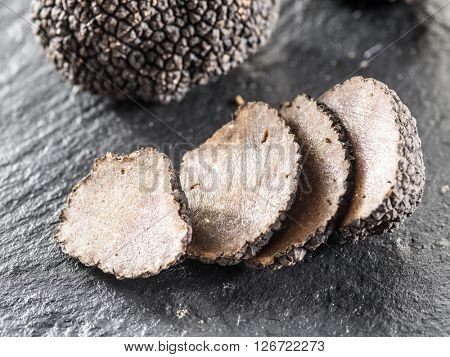 Truffle slices on the graphite board.