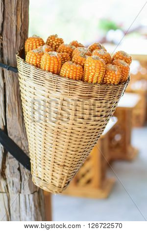 dry gold orange corn in rattan basket ** Note: Soft Focus at 100%, best at smaller sizes