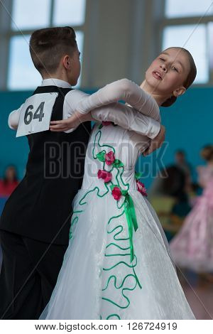 Minsk Belarus -April 3 2016: Panasyuk Maksim and Belyankina Liana Perform Juvenile-1 Standard Program on the IDSA Championship Kinezis Star Cup - 2016 in April 3 2016 in Minsk Republic of Belarus