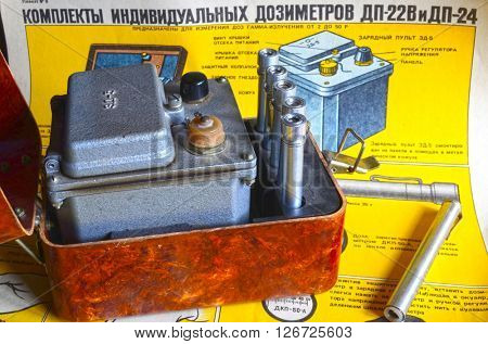 Vintage Soviet military individual radiometers set DP-24.Background - poster Soviet Civil Defense: Sets of individual radiometers DP-24 & DP-22v,design and usage(60-th).At April 19,2016  Kiev,Ukraine