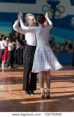 Minsk Belarus -April 3 2016: Unidentified Dance Couple Performs Juvenile-1 Standard European Program on the IDSA Championship Kinezis Star Cup - 2016 in April 3 2016 in Minsk Republic of Belarus