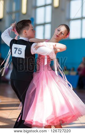 Minsk Belarus -April 3 2016: Troyanovskiy Andrey and Ersh Anna Perform Juvenile-1 Standard European Program on the IDSA Championship Kinezis Star Cup - 2016 in April 3 2016 in Minsk Republic of Belarus