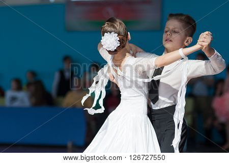 Minsk Belarus -April 3 2016: Hamko Egor and Bloshentceva Diana Perform Juvenile-1 Standard European Program on the IDSA Championship Kinezis Star Cup - 2016 in April 3 2016 in Minsk Republic of Belarus