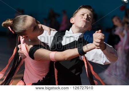 Minsk Belarus -April 3 2016: Rakovich Nikita and Trohina Anastasiya Perform Juvenile-1 Standard European Program on the IDSA Championship Kinezis Star Cup - 2016 in April 3 2016 in Minsk Republic of Belarus