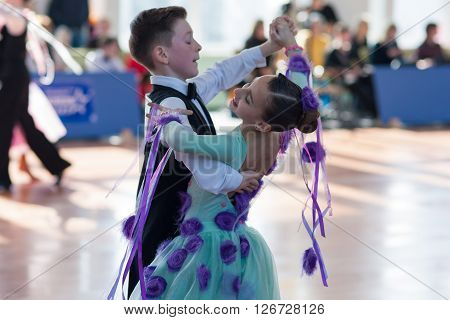 Minsk Belarus -April 3 2016: Evoyan Veniamin and Strelchenya Kseniya Perform Juvenile-1 Standard European Program on the IDSA Championship Kinezis Star Cup - 2016 in April 3 2016 in Minsk Republic of Belarus