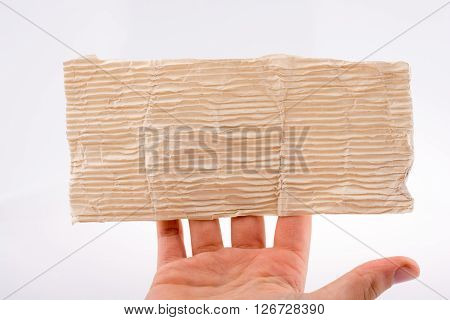 Wrinkled paper in hand on a white  background