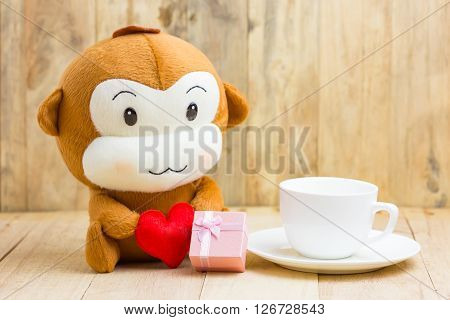 Happy Smiling Monkey Doll Hugging Red Heart With Gift Box And Coffee Cupsitting On Wood, Gift Of Lov