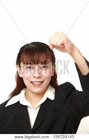 Asian businesswoman in a victory pose on white background