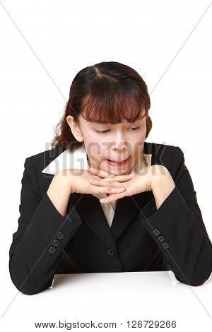 studio shot of depressed businesswoman on white background