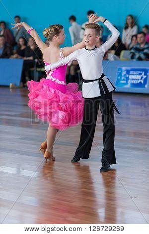 Minsk Belarus -April 3 2016: Strelskiy Aleksander and Ratomskaya Anna Perform Juvenile-1 Latin-American Program on the IDSA Championship Kinezis Star Cup - 2016 in April 3 2016 in Minsk Republic of Belarus