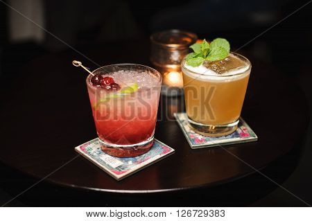 Two different colorfull cocktails on wooden table